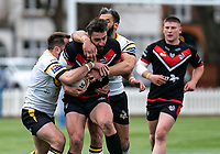 Will Lovell of London Broncos tries to power past Jason Bass of York City Knights and Ryan Atkins of York City Knights during the Betfred Challenge Cup match between London Broncos and York City Knights at The Rock, Rosslyn Park, London, England on 28 March 2021. Photo by Liam McAvoy.