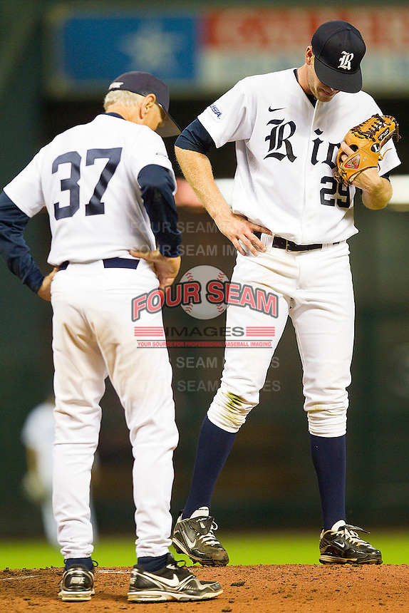 Rice Owls head coach Wayne Graham #37 visits the mound to chat with Matthew Reckling #29 during the game against the Kentucky Wildcats at Minute Maid Park on March 4, 2011 in Houston, Texas.  Photo by Brian Westerholt / Four Seam Images
