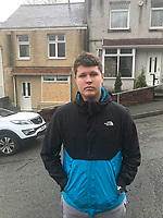 """Pictured: Alex Dubjaga, who lives opposite the houses that got vandalised and witnessed it all Waun-Wen Road in the Mayhill area of Swansea, Wales, UK. Friday 21 May 2021<br /> Re: Gangs of """"yobs"""" have been setting fire to cars and rolling them down a hill in Swansea, Wales, UK.<br /> South Wales Police said they attended """"large scale disorder"""" in the Mayhill area of the city on Thursday evening."""