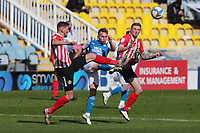 Sunderland's Charlie Wyke and Peterborough United's Louis Reed during Peterborough United vs Sunderland AFC, Sky Bet EFL League 1 Football at London Road on 5th April 2021