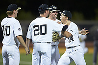 Bobby Hearn (right) is fired up as he comes off the field after getting the third out in the 7th inning against the North Carolina State Wolfpack at David F. Couch Ballpark on April 18, 2019 in  Winston-Salem, North Carolina. The Demon Deacons defeated the Wolfpack 7-3. (Brian Westerholt/Four Seam Images)