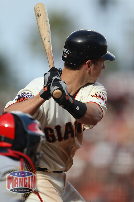 SAN FRANCISCO - APRIL 8:  Buster Posey of the San Francisco Giants bats against the St. Louis Cardinals during Opening Day at AT&T Park on April 8, 2011 in San Francisco, California. Photo by Brad Mangin