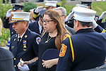 Manasquan FD 1st Lieutenant Jeff Ely escorts Stefanie McCann into the funeral for her husband, Manasquan volunteer firefighter Dan McCann. McCann, a firefighter EMT with more than 25 years experience, died last week after a fire department training exercise in Manasquan.  9/21/16  (Andrew Mills | NJ Advance Media for NJ.com)