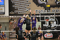 Sophie Snodgrass (10) and Brooke Rockwell of Fayetteville go up for block against Victoria Otter (2) of Bentonville on Thursday, Oct.  7, 2021, during play at Tiger Arena in Bentonville. Visit nwaonline.com/211008Daily/ for today's photo gallery.<br /> (Special to the NWA Democrat-Gazette/David Beach)