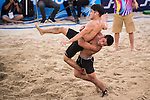 Wrestlers compete during the Beach Wrestling Men's competition between Korea and Mongolia on Day Eight of the 5th Asian Beach Games 2016 at Bien Dong Park on 01 October 2016, in Danang, Vietnam. Photo by Marcio Machado / Power Sport Images