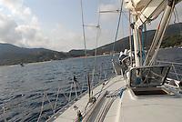 - sailing boat in navigation along the coast of Elba island....- barca a vela in navigazione lungo la costa dell'isola d'Elba