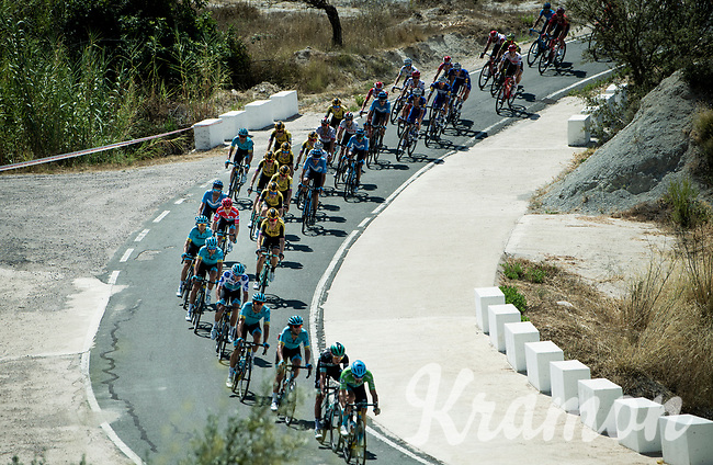 red jersey (overall leader) Miguel Angel Lopez (COL/Astana) well up front in the peloton<br /> <br /> Stage 2: Benidorm to Calpe (199.6km)<br /> La Vuelta 2019<br /> <br /> ©kramon