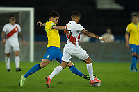 5th July 2021; Nilton Santos Stadium, Rio de Janeiro, Brazil; Copa America, Brazil versus Peru; Lucas Paquetá of Brazil tackled by Yoshimar Yotún of Peru