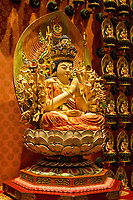 Avalokiteśvara, Guardian Deity for Persons born in the Year of the Rat.  A Bodhisattva Embodying Compassion, in Wall Nitch Surrounding the Prayer Hall, Buddha Tooth Relic Temple, Singapore.