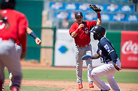 Springfield Cardinals infielder Irving Lopez (11) looks to tag Northwest Arkansas Naturals infielder D.J. Burt (1) in a run-down on May 19, 2019, at Arvest Ballpark in Springdale, Arkansas. (Jason Ivester/Four Seam Images)