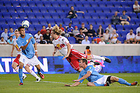Karsten Smith (5) of FC New York heads the ball as Stephen Keel (22) of the New York Red Bulls dives for the ball. The New York Red Bulls defeated FC New York 2-1 during a third round match of the 2011 Lamar Hunt US Open Cup at Red Bull Arena in Harrison, NJ, on June 28, 2011.