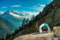 Martina Cufar practising yoga with the Aiguillette d'Argentiere and the Mont Blanc Massif in the background.