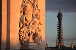 The sculpture of La Résistance on Arc de Triomphe under evening sun light with Eiffel Tower in background. Paris. France