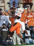 Oklahoma State Cowboys cornerback Brodrick Brown (19) goes up for the interception over Texas Longhorns wide receiver James Kirkendoll (11) during the game between the Oklahoma State Cowboys and the University of Texas in Austin Texas Longhorns at the Daryl K. Royal- Texas Memorial Stadium in Austin, Texas. The Oklahoma State Cowboys defeated the Texas Longhorns 33 to 16.