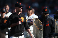 SAN FRANCISCO, CA - SEPTEMBER 29:  Buster Posey #28 of the San Francisco Giants speaks during a ceremony celebrating the career of manager Bruce Bochy after the game between the Los Angeles Dodgers and the San Francisco Giants at Oracle Park on Sunday, September 29, 2019 in San Francisco, California. (Photo by Brad Mangin)