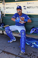OAKLAND, CA - MAY 19:  Salvador Perez #13 of the Kansas City Royals gets ready in the dugout before the game against the Oakland Athletics at O.co Coliseum on Sunday May 19, 2013 in Oakland, California. Photo by Brad Mangin