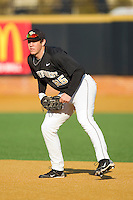 First baseman Matt Conway #25 of the Wake Forest Demon Deacons on defense against the Western Carolina Catamounts at Gene Hooks Field on February 22, 2011 in Winston-Salem, North Carolina.  Photo by Brian Westerholt / Four Seam Images