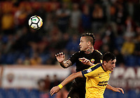 Calcio, Serie A: Roma, stadio Olimpico, 16 settembre 2017.<br /> Roma's Radja Nainggolan (l) in action with Verona's Alex Ferrari (r) during the Italian Serie A football match between AS Roma and Hellas Verona at Rome's Olympic stadium, September 16, 2017.<br /> UPDATE IMAGES PRESS/Isabella Bonotto