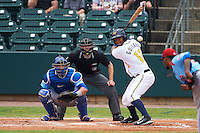 Montgomery Biscuits shortstop Hector Guevara (13) at bat in front of catcher Kyle Schwarber and umpire Alex Ransom during a game against the Tennessee Smokies on May 25, 2015 at Riverwalk Stadium in Montgomery, Alabama.  Tennessee defeated Montgomery 6-3 as the game was called after eight innings due to rain.  (Mike Janes/Four Seam Images)