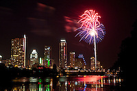 Fireworks explode against a night sky in colorful display over Ladybird Lake in Austin, Texas