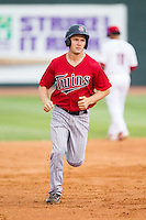 Max Murphy (13) of the Elizabethton Twins rounds the bases after hitting a home run against the Johnson City Cardinals at Cardinal Park on July 27, 2014 in Johnson City, Tennessee.  The game was suspended in the top of the 5th inning with the Twins leading the Cardinals 7-6.  (Brian Westerholt/Four Seam Images)