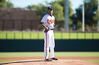 Glendale Desert Dogs starting pitcher Chris Lee (63), of the Baltimore Orioles organization, looks in for the sign during an Arizona Fall League game against the Mesa Solar Sox at Camelback Ranch on November 12, 2018 in Glendale, Arizona. Glendale defeated Mesa 4-2. (Zachary Lucy/Four Seam Images)