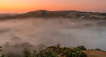 WEATHER INPUT - Misty start to hot sunny day.<br /> <br /> Pictured:  Sunrise this moring at Corfe Castle, a village and civil parish in Dorset. The ruined castle of the same name stands over a gap in the Purbeck Hills between Wareham and Swanage. <br /> <br /> Please byline: Steve Hogan/Solent News<br /> <br /> © Steve Hogan/Solent News & Photo Agency<br /> UK +44 (0) 2380 458800