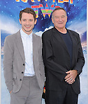 Elijah Wood and Robin Williams at The Warber Bros. Pictures'  World Premiere of HAPPY FEET TWO held at The Grauman's Chinese Theatre in Hollywood, California on November 13,2011                                                                               © 2011 Hollywood Press Agency