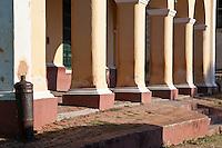 Cuba, Trinidad.  Columns in front of the Palacio Brunet.