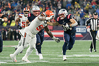 FOXBOROUGH, MA - OCTOBER 27: New England Patriots Runningback Rex Burkhead #34 tries to hand off Cleveland Browns Defensive tackle Sheldon Richardson #98 during a game between Cleveland Browns and New Enlgand Patriots at Gillettes on October 27, 2019 in Foxborough, Massachusetts.
