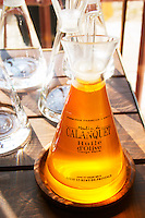 Glass bottle with olive oil first cold pressing at the Olive oil mill Moulin du Calanquet de Saint St Remy de Provence, Bouches du Rhone, France