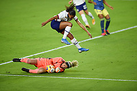 ORLANDO, FL - JANUARY 18: Margaret Purce #23 of the United States leaps over Sandra Sepulveda #12 of Colombia during a game between Colombia and USWNT at Exploria Stadium on January 18, 2021 in Orlando, Florida.