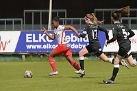 Esther Buabadi (24) of Zulte Waregem and Chloe Van Mingeroet (17) of Eendracht Aalst pictured on her way to the opening goal during a female soccer game between Eendracht Aalst and SV Zulte Waregem on the fourth matchday of play off 2 of the 2020 - 2021 season of Belgian Scooore Womens Super League , Saturday 1 st of May 2021  in Aalst , Belgium . PHOTO SPORTPIX.BE | SPP | DIRK VUYLSTEKE