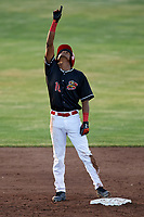 Batavia Muckdogs center fielder Brayan Hernandez (18) points skyward while standing on second base during a game against the West Virginia Black Bears on June 20, 2018 at Dwyer Stadium in Batavia, New York.  West Virginia defeated Batavia 4-3.  (Mike Janes/Four Seam Images)