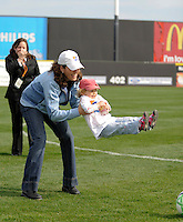 Julie Foudy with daughter Isabel have the ceremonial first kick. The Los Angeles Sol defeated Sky Blue FC 2-0 during a Women's Professional Soccer match at TD Bank Ballpark in Bridgewater, NJ, on April 5, 2009. Photo by Howard C. Smith/isiphotos.com