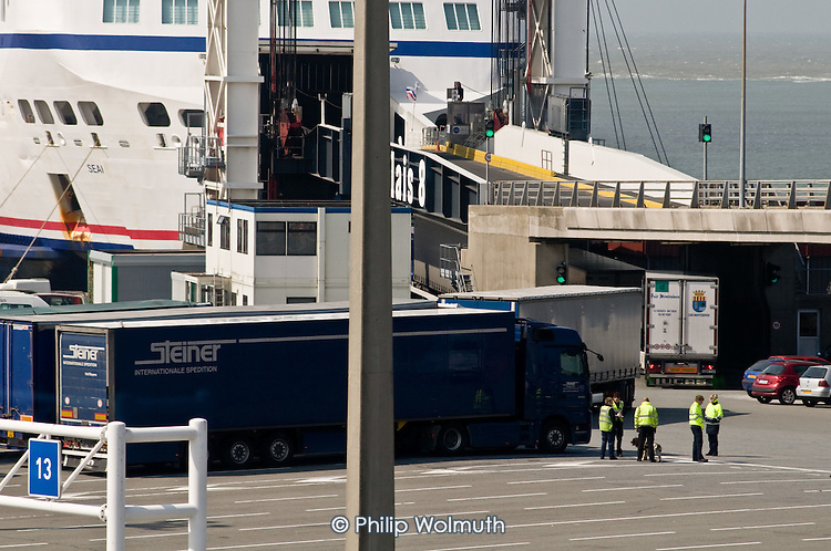 Border police check for stowaways in lorries waiting to board a cross-Channel ferry in Calais