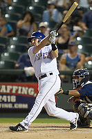 Round Rock Express shortstop Brendan Harris (6) swings the bat against the Oklahoma City RedHawks during the Pacific Coast League baseball game on August 25, 2013 at the Dell Diamond in Round Rock, Texas. Round Rock defeated Oklahoma City 9-2. (Andrew Woolley/Four Seam Images)