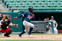 Reno Aces shortstop Domingo Leyba (26) hits an RBI-single during a game against the Fresno Grizzlies at Chukchansi Park on April 8, 2019 in Fresno, California. Fresno defeated Reno 7-6. (Zachary Lucy/Four Seam Images)