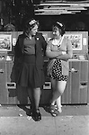 Blackpool teenage girls on holiday wearing Kiss Me Quick, Squeeze Me Slow hat hats 1970s working class young women 1974 UK