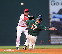 August 13, 2009: Second baseman Ryan Dent (22) turns the first half of a double play, making the putout on Robert Taylor (17) of the Greensboro Grasshoppers  during a game at Fluor Field at the West End in Greenville, S.C. Photo by: Tom Priddy/Four Seam Images