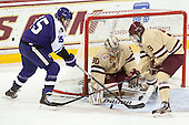 Castan Sommer (HC - 15) battles with Brendan Silk (BC - 9) before scoring on Thatcher Demko (BC - 30). - The visiting College of the Holy Cross Crusaders defeated the Boston College Eagles 5-4 on Friday, November 29, 2013, at Kelley Rink in Conte Forum in Chestnut Hill, Massachusetts.