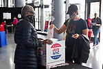 BROOKLYN, NY — OCTOBER 24, 2020:  A voter drops off a mail-in ballot at the Barclay's Center, during the first day of early voting in the U.S. Presidential Election, on October 24, 2020 in Brooklyn, NY.  Photograph by Michael Nagle