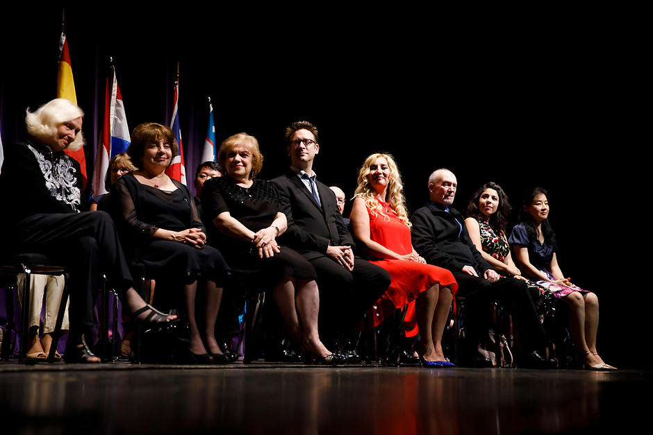 USA International Harp Competition Founder and Artistic Director Susann McDonald, left, and jury members Skaila Kanga, Milda Agazarian, Sylvain Blassel, Jana Bouskova, Mario Falcao, Anneleen Lenaerts and Dan Yu sit on stage during the awards ceremony of the 11th USA International Harp Competition at Indiana University in Bloomington, Indiana on Saturday, July 13, 2019. (Photo by James Brosher)