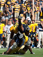 Mychal Kendricks and D.J. Holt combine in attempt to sack Kevin Prince. The California Golden Bears defeated the UCLA Bruins 35-7 at Memorial Stadium in Berkeley, California on October 9th, 2010.