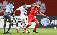 TORONTO, ON - OCTOBER 15: Weston McKennie #8 of the United States turns with the ball past Liam Fraser #13 of Canada during a game between Canada and USMNT at BMO Field on October 15, 2019 in Toronto, Canada.