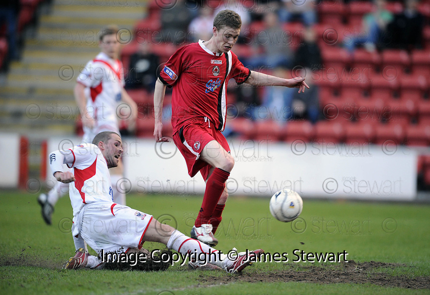 07/05/2008   Copyright Pic: James Stewart.File Name : sct_jspa03_airdrie_v_clyde.MARC SMYTH MAKES THE CHALLENGE JUST AS PAT CLARKE PREPARES TO SHOOT.James Stewart Photo Agency 19 Carronlea Drive, Falkirk. FK2 8DN      Vat Reg No. 607 6932 25.Studio      : +44 (0)1324 611191 .Mobile      : +44 (0)7721 416997.E-mail  :  jim@jspa.co.uk.If you require further information then contact Jim Stewart on any of the numbers above........