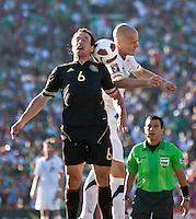 PASADENA, CA – June 25, 2011: Mexico player Gerardo Torrado (6) and USA player Michael Bradley (4) during the Gold Cup Final match between USA and Mexico at the Rose Bowl in Pasadena, California. Final score USA 2 and Mexico 4.
