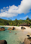 Seychelles, Island Mahe, Anse Takamaka: people at the beach<br />