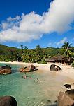 Seychelles, Island Mahe, Anse Takamaka: people at the beach<br />