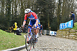The peloton including Adrien Petit (FRA) Total Direct Energie summit the Muur van Geraardsbergen during the 76th edition of Omloop Het Nieuwsblad 2021 running 200km from Gent to Ninove, Belgium. 27th February 2021  <br /> Picture: Serge Waldbillig | Cyclefile<br /> <br /> All photos usage must carry mandatory copyright credit (© Cyclefile | Serge Waldbillig)